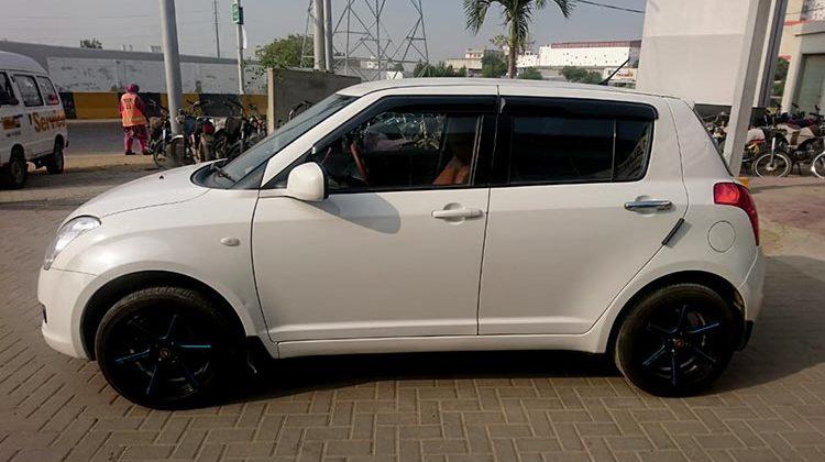 White Suzuki swift for sale