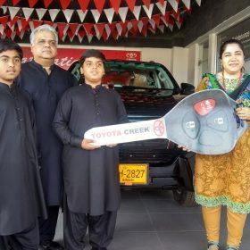 Happy Customer Receiving their Car Key