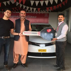 Happy Customer Receiving New Car